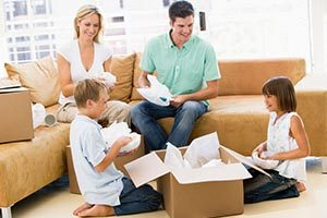 Image of a happy family that our movers DeLand FL helped.
