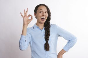 A woman showing an a-okay sign.