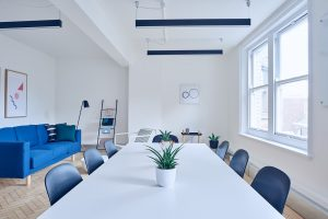 A white and blue conference room.