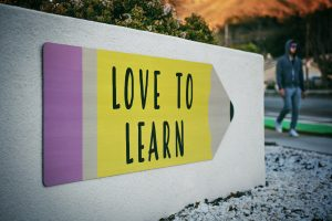 """Sign saying """"love to learn"""""""
