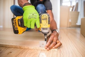 Will your movers assemble your furniture? - man with a drill