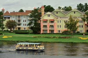 should you invest in Orlando rental real estate - Houses in front of a body of water.