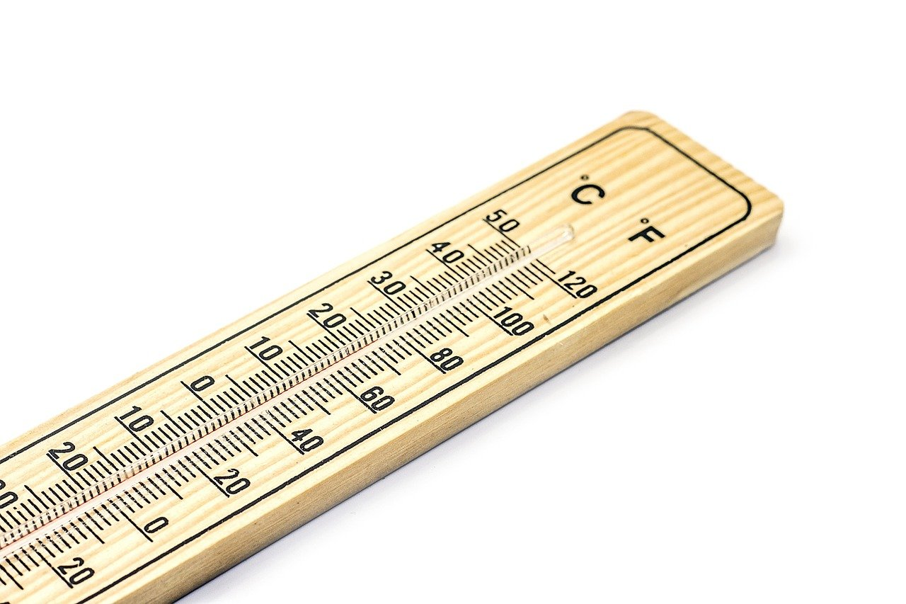 A thermometer and a white background