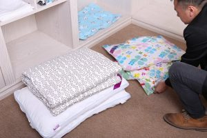 To save space when packing clothes, just compress them!