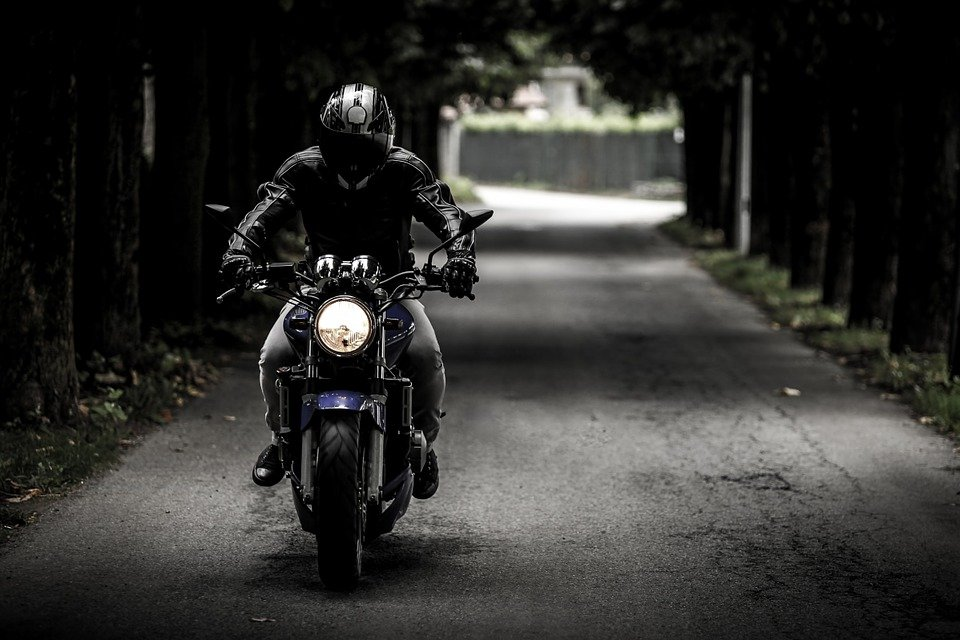A man on a motorcycle.