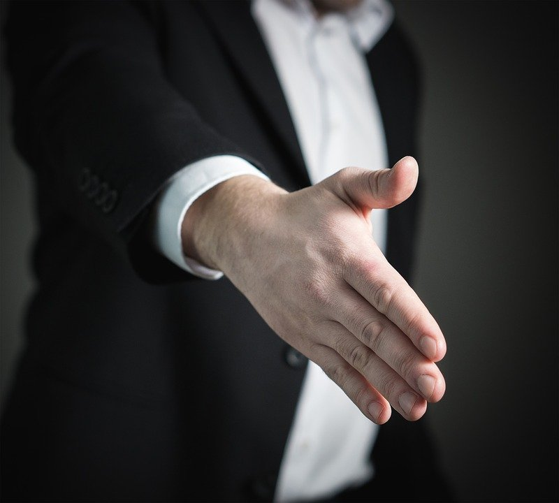 A handshake after negotiating tactics worked.
