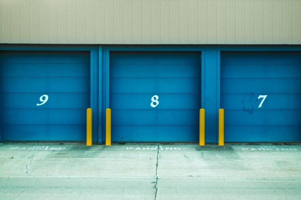 three blue storage units