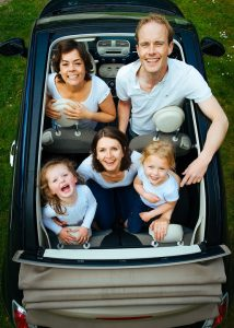 Family in a car, smiling
