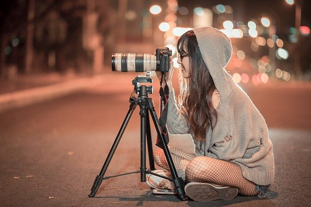 girl with a camera on the street