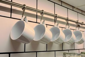 Wash before you pack your glassware for storage - cups on the wall