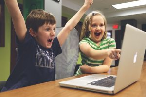Children playing games on laptop - unpack in a day