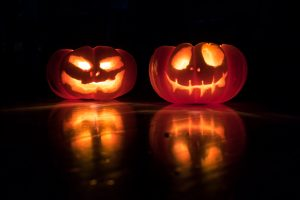 two scary looking pumpkins