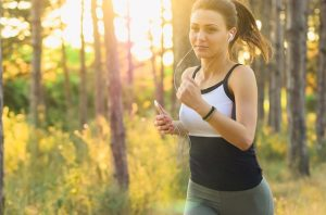 a girl jogging in the woods