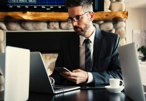 A businessman sitting at his laptop