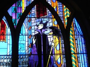 A Maleficent-themed stained glass window.