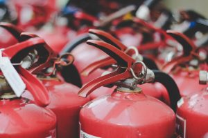 Find someone else to move your fire extinguishers for you