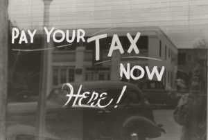a sign that says pay for taxes