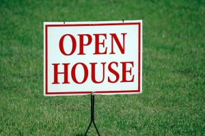 sign that says open house